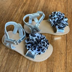 Stepping Stones adorable sandals with bow on top.